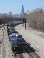 M338 heads south along the Metra Electric tracks as downtown looms