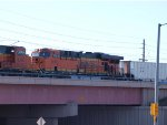 BNSF 6135 #3 power in  a NB coal train at 9:14am (stopped in siding)
