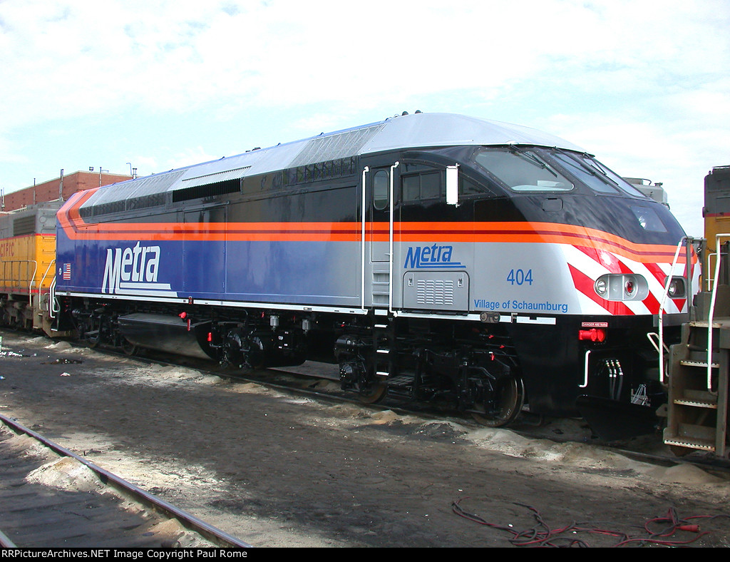 METRA 404, MPI MP36PH-3S, NEW, enroute to owner, at Proviso Yard