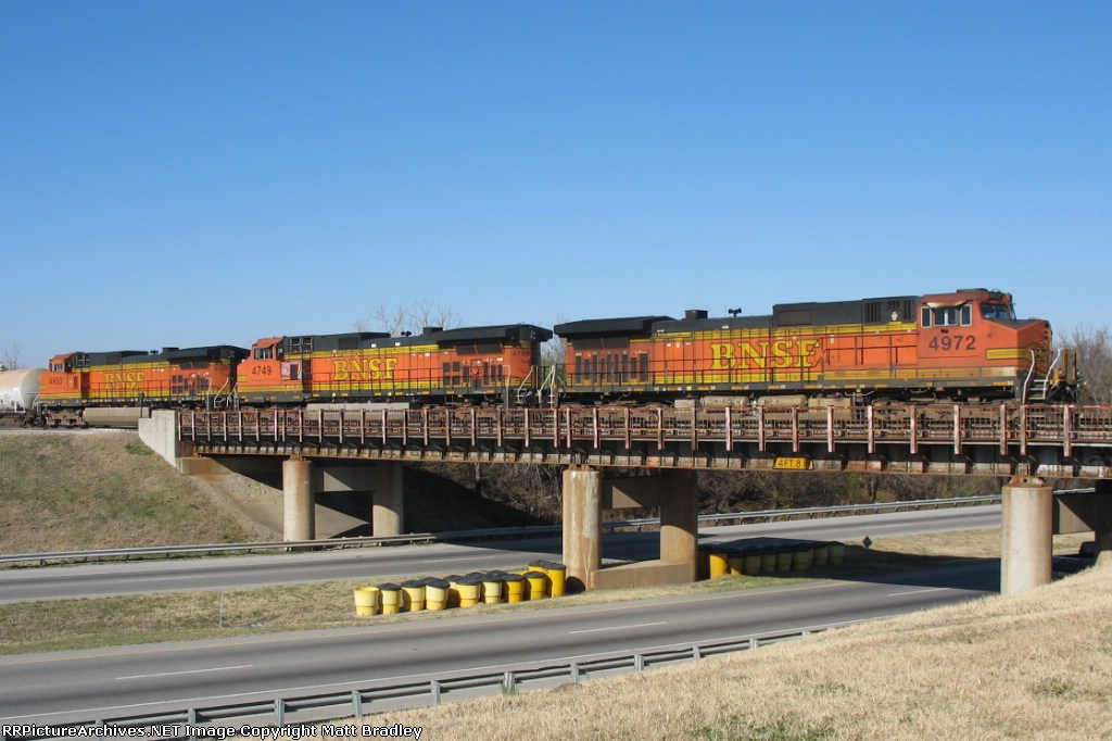 BNSF 4972 leads the way over Hwy 169