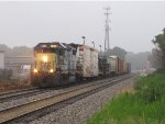 CSX 2506 brings D707-28 back into town on a foggy morning