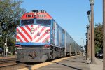 Metra F40PH # 175 eases to a stop as it makes its way west into the sun