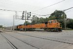 A pair of BNSF SD70MAC's lead a coal train across Lincoln Ave on an over cast afternoon