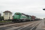 An eastbound CP freight with CITX power departs Bensenville Yard on an overcast Friday