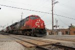 A southbound freight out of CN's Schiller Park yard, enters the IHB  as it crosses the CP/Metra line in the background
