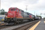 A CN train waits to cross the CP/Metra line and enter the IHB with a C40-8 that was picked up from the UP and was orig. C&NW