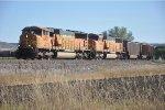 Loaded coal train roll around curve