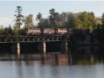 WC 7520 leading train across Escanaba River