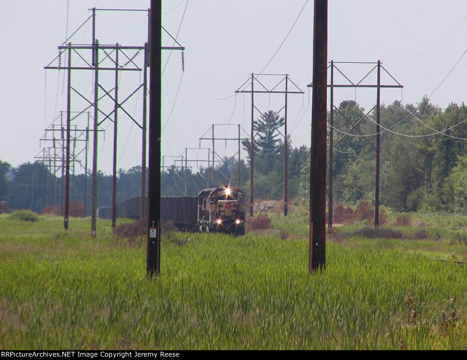WC 7514 framed aproaching M-35 crossing on LS&I