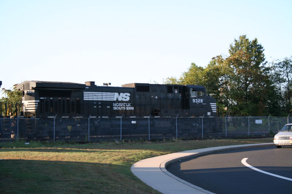 NS 9328 Passing Downtown Manville