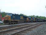 CSX 5203 Leads a train with two sets of Road Slugs