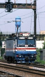 Amtrak AEM-7 #950 has just brought the Atlantic City train from New York, and is heading east down 5 track to clear the the interlocking and get a signal to continue its journey west to 30th St.  Frankford Junction, Philadelphia, Pa. 1989