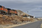 BNSF 4666 Meeting a Loram Rail Grinder