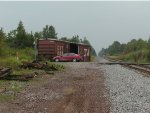 Box Car derailed by Whites Grocery west of Escanaba
