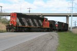 CN 9673 crossing road and entering yard