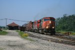 CN 5702 rolling past depot and sidings