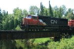 CN 5702 passing over bridge by Milecoquins Lake