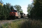 CN 2611 leading train by Lake Bluff crossing to yard