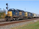 CSX SD40-2 8090  with CSX SD40-2 8837 power a mixed freight westbound.