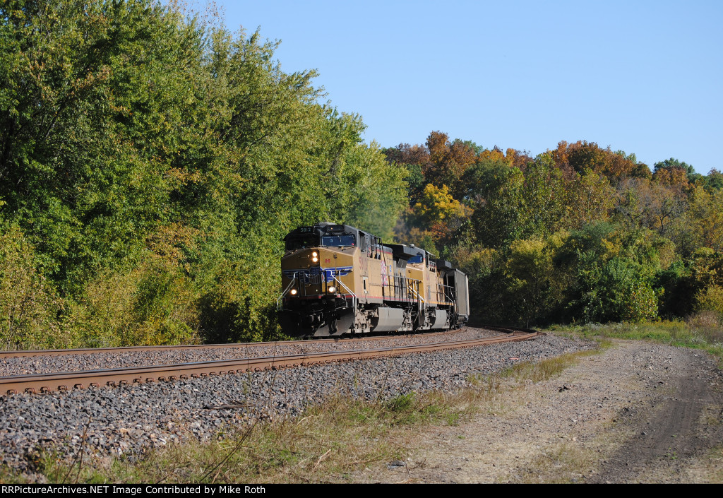 UP 5614 with westbound hoppers.