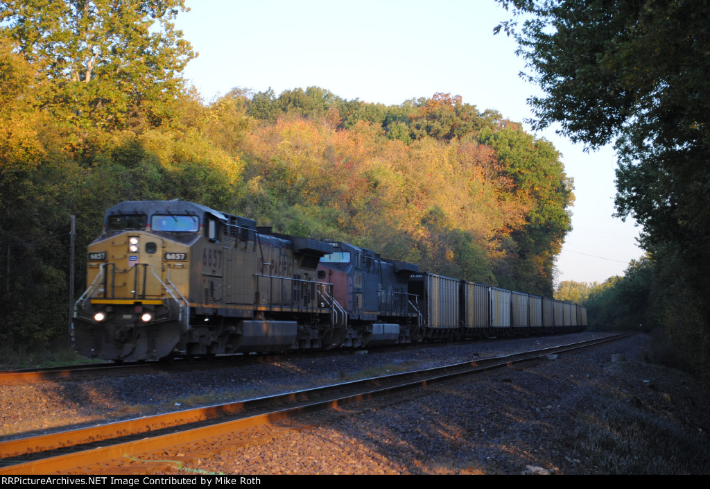 Union Pacific 6857 goes east with loaded coal.
