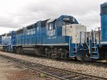 Kelowna Pacific Railway train passes through the Okanagan Valley Railways yard. LLPX 2606.