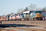 CSX 561 leads Q433 with three MBTA units in tow
