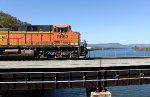 BNSF 5663 leading a scherer train across the Tennessee River
