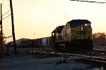 CSX 7903 leads Q334 out of the yard at sunset