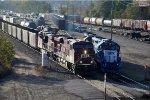 Loaded coal train departs yard