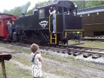 My young railfan friend taking pictures with my camera