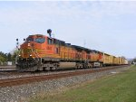 BNSF 4667 heads west with a mixed freight.