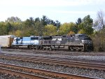 NS 9950 with an Oakway helper leads an autorack train east.