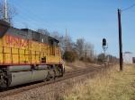 UP 8217 Passes a Flashing Yellow