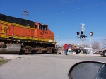Conductor walks BNSF 4777 across the road.