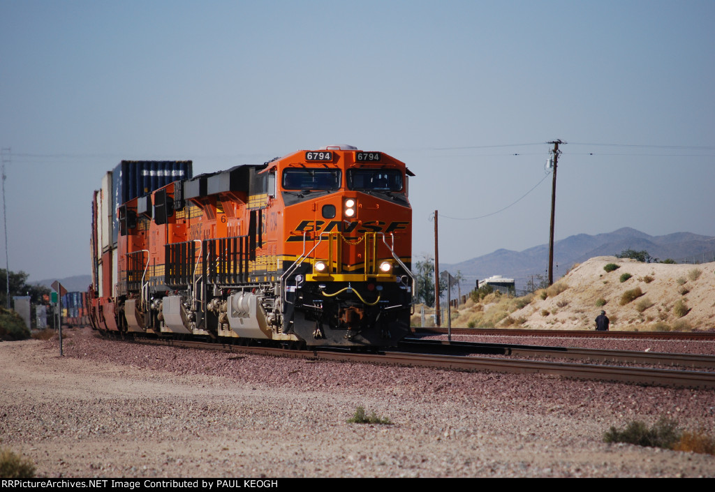 BNSF 6794 with BNSF 6793 behind her head eastward into the BNSF Barstow yard for a crew change.