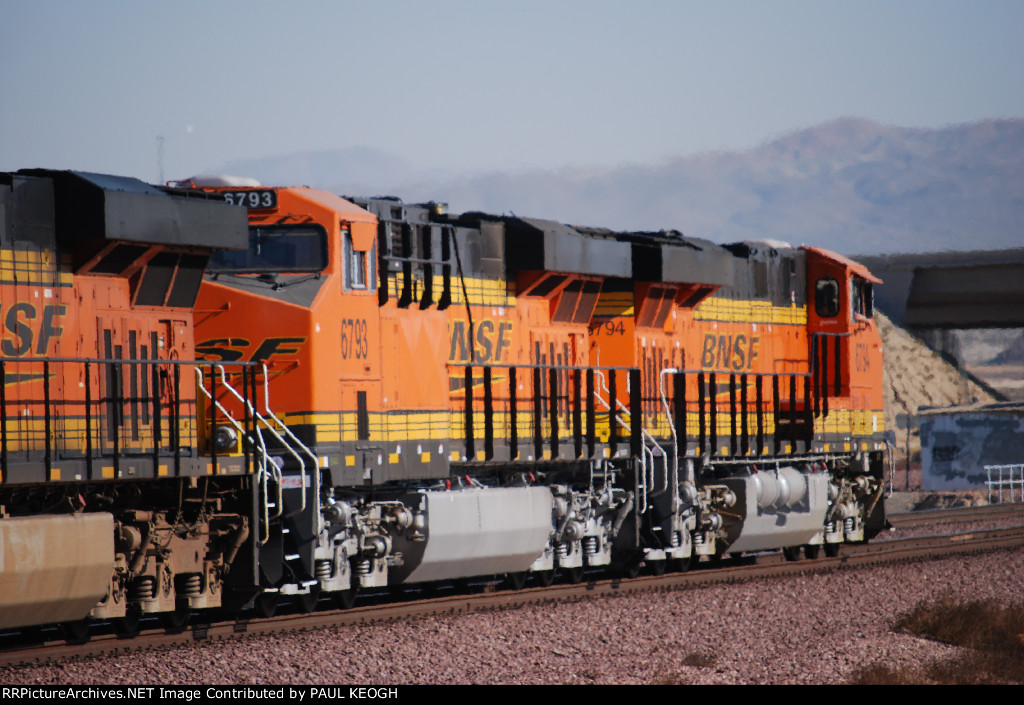 BNSF 6793 and BNSF 6794 head into the yard in this zoom shot of them.