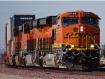 Zoom in shot of BNSF 6794 and BNSF 6793 as they head into BNSF Barstow.