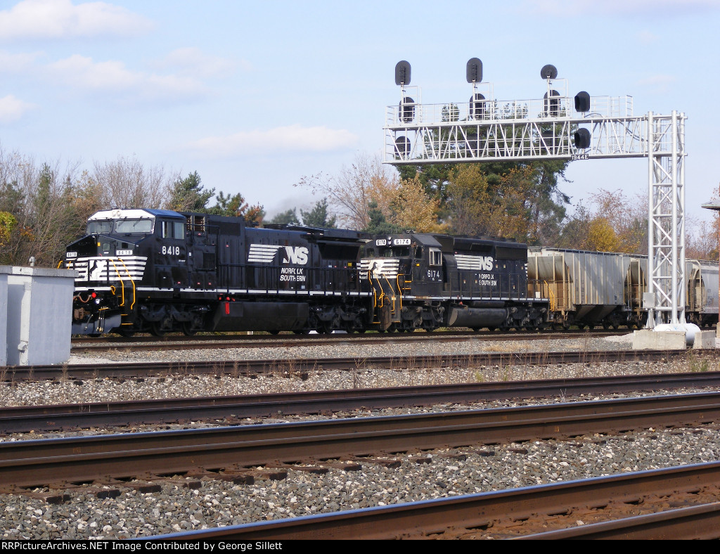 NS 8418 leads a mixed freight west.