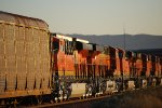 The Two Broke and VERY, Very Brand New C4's Reflect the Rising California Sun as they slow down to enter the BNSF Barstow yard as BNSF 6795's Z Train passes them going west to LA.