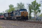 Q410 heads north with a genset in tow and HTM boxcar logo on the point