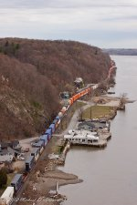 CSX Q161 with a sea of colorful orange intermodal containers snakes its way to Chicago, IL.
