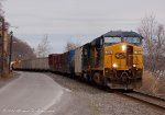 The crew of CSX Q409 leaves its door open for fresh air on a nice warm March day.