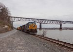 The Walkway over the Hudson provides the backdrop for CSX Q433 as it makes its way to Oak Island in NJ.