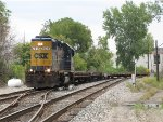 CSX 2635 returns towards the yard with 5 empty flats from American Cast Iron