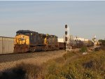 CSX 321 & 7500 cruise downhill as they lead Q335-01 by the west end of Fox