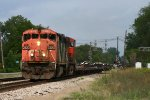 With empty windmill flats on the headend, CN 393 Heads west behind a pair of CN GEs.