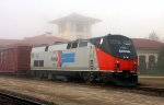Amtrak heritage unit #156 in the early morning fog