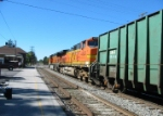 BNSF 4828 trails with trash cars