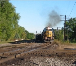 CSX 8646 heads south about to cross the NS